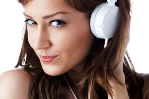 Kozzi-beautiful-young-woman-with-headphones-588 X 883